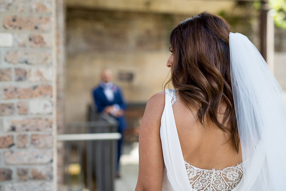 view of bride from the back with veil