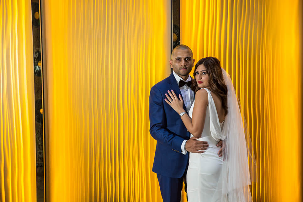 Desiree and Steve in front of yellow curtain